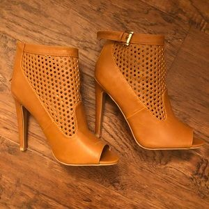 Brown heels with little holes and buckle